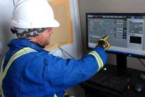 Geophysicist reviewing data on a computer screen